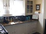 Kitchen w/granite countertops.