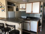 Kitchen fully loaded, dishwasher, stove/oven, fridge/freezer, cookery and utensils, plates, cups and