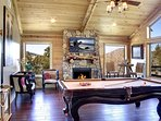 2nd floor Game Room with pool table, TV and deck
