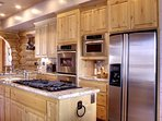 Double ovens, gas stove, and stainless steel appliances