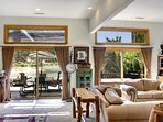 Great room opens with two sliding doors to patio