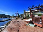 The expansive patio and dramatic granite boulder effect along the shoreline