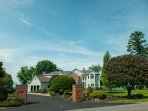 Breathtaking lake front estate with large driveway and entry.