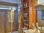 Perform nightly bedtime routines in this full bathroom with a glass enclosed shower.