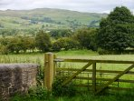 Views from the front of the cottage looking towards Rombalds moor and Skipton in the distance.