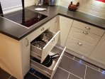 Kitchen fitted with pots and pans as well as an American fridge freezer with ice and water dispenser