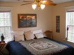 West end bedroom has a newer King size bed (Firm) with large closet an three large windows.