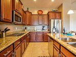 The kitchen is fully equipped with top-of-the-line appliances and granite countertops.