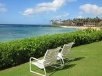 Two Complimentary chairs waiting for you on the great lawn overlooking the beach