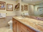 Private master bathroom with lovely granite and stone.