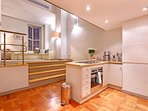 Open plan kitchen with a dishwasher