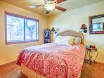 Guest bedroom with queen, comfortable and cheerful with view of trees