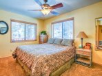 Luxury Cal King with windows with views of trees and spacious, adjacent master bath