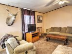 Enter into the home and step inside the open-concept living room, where comfortable seating surrounds a large flat...