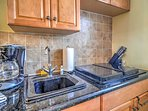 The space is complete with 4-burner stove, granite countertops, microwave, toaster,  coffee maker and more!