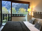 master bedroom with access to large balcony overlooking Mont Blanc and Chamonix town.