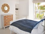 Ensuite kingsize room has far reaching views to the sea over the garden