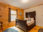 Main level bedroom w/ double bed