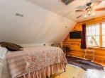 Upstairs bedroom w/ queen bed and TV