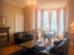 Spacious sitting room with large bay window offering stunning sea views