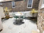 Sunny courtyard at The Lifeboat House