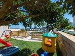 Fenced playground area for children next to the pool!