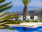 Sunbathing area, relax on our comfortable sun-beds by the pool together with sea views