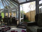 Double doors leading from the conservatory to the dog friendly private garden.