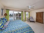 Master Bedroom with a kind size bed and a great view of the lake
