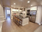 Kitchen. Includes double ovens, 6 burner gas range, kitchenmaid mixer, coffee maker, blender.