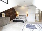 Top floor master bedroom sleeps 3 guest with en-suite shower room