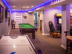 great game room with pool table, air hockey and various other arcade games