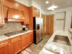 Kitchen - Granite counter-tops and stainless steal appliances in the gourmet kitchen.