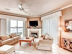 The Living Area Features a Large HD Flat-Screen TV and Beautiful Views of The Lake