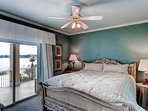 An Additional King Bedroom Located On The 1st Floor Also Overlooking Lake and Pool Area