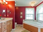 Spacious bath with Double Sink Vanity, Jacuzzi & Shower