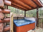 Take a soothing soak in the hot tub out on the spacious back deck.
