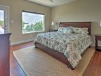 The master bedroom features a comfy king bed.