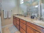 The master bathroom  features new granite counters and a Jack-and-Jill sink.