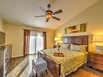 The master bedroom features a king-sized bed, flat-screen TV and en suite bathroom.