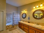 There's plenty of counterspace to freshen up for the day in the master bathroom.