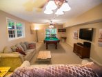 Second family room with pool table, bar, and fridge