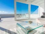 rooftop living and bedroom with spectacular ocean and sky views thru floor-to-ceiling sliding doors.