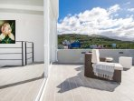 mountain/hill views from the roof top terrace. Lounge furniture invite to relax.