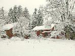 Estate in winter, Schoolhouse is barn on right.