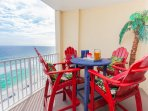 Oversize balcony with table and 4 chairs, 3 chase lounges and 2 arm chairs