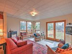 Head around back to access the fully finished, walk-in basement and step inside the living room's rustic accommodations.