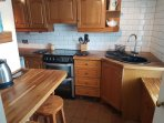Well equipped kitchen with real oak worktops