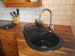 Sink with Victorian style mixer and matching drainer and cutlery basket