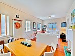 Combined living/dining room with peak-a-boo ocean views.